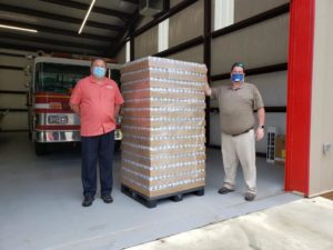 The Lewis Bear Company helps deliver water for local relief efforts.